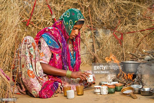 CONTENT] Indian teenage girl preparing chai on traditional chulha Pushkar Rajashan India
