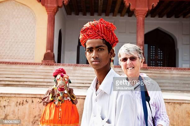 indian teenager and senior tourist