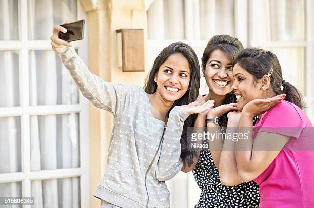 indian teenager girls taking a selfie - indian college girls stock photos and pictures