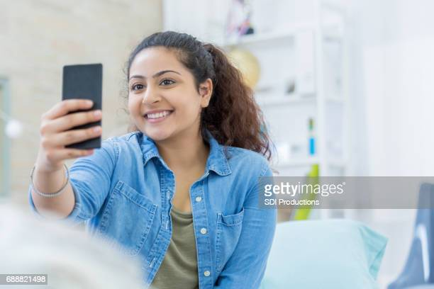 indian teenager takes selfie at home - indian college girls stock photos and pictures
