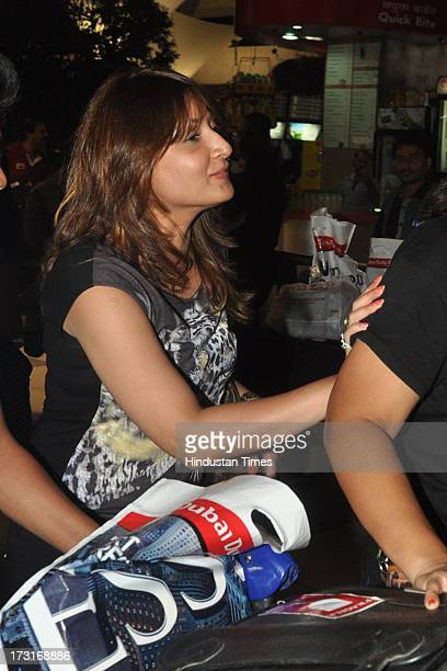 Indian television actor Urvashi Dholakia at the Mumbai Airport as she returned from Macau after attending the IIFA Awards 2013 on July 8, 2013 in...