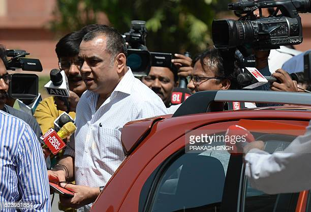 Indian television journalists question Bhartiya Janta Party MP Paresh Rawal as he arrives in a evendigit car during the begining of the second part...