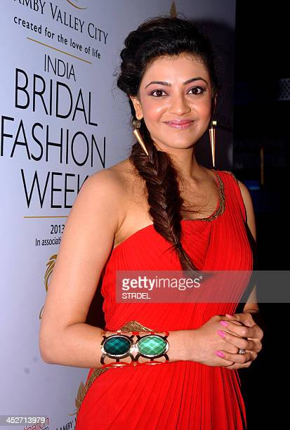 Indian Telugu actress Kajal Aggarwal poses as she attends the Aamby Valley India Bridal Fashion Week 2013 fashion show in Mumbai late November 30...