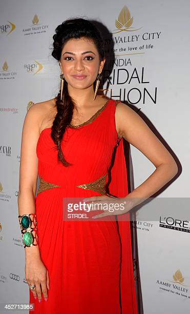 Indian Telugu actress Kajal Aggarwal poses as she attends the Aamby Valley India Bridal Fashion Week 2013 fashion show in Mumbai late November 30...