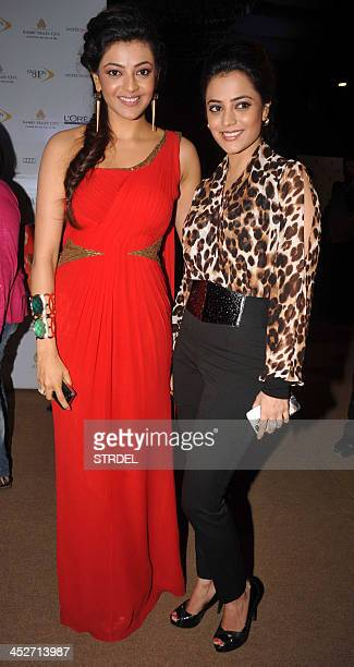 Indian Telugu actress Kajal Aggarwal poses with her sister sister Nisha Aggarwal as they attend the Aamby Valley India Bridal Fashion Week 2013...