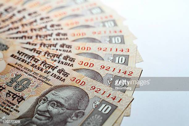 Indian ten rupee banknotes are arranged for a photograph in Mumbai India on Monday June 10 2013 India's rupee sank to a record as investors favored...