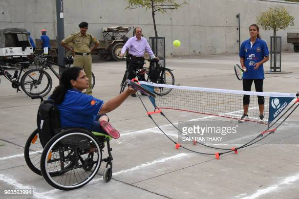 Indian tennis player Ankita Raina and wheelchair tennis player Madhu Bagri play an exhibition tennis match at Sabarmati River Front in Ahmedabad on...