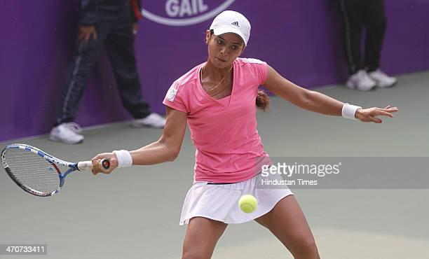 Indian tennis player Ankita Raina in action against Noppawan Lertcheewakaran of Thailand during the Delhi Open ITF Womens Tennis Tournament at DLTA...