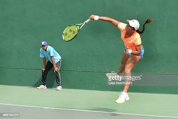 Indian tennis player Ankita Raina plays against Indian Bhimjyani Devanshi on the second day of the International Tennis Federation's 25000 dollar...