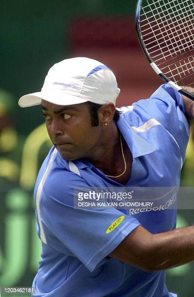 Indian tennis player Leander Paes eyes the ball during his singles Davis Cup match against Mark Nielsen of New Zealand in Calcutta, 04 April 2003....
