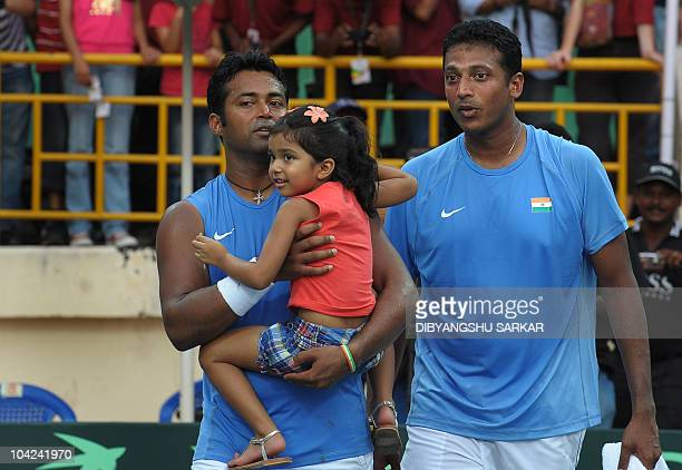 Indian tennis player Leander Paes holds his daughter after his win in the doubles match with Mahesh Bhupathi to Brazilian pair Marcelo Melo and Bruno...