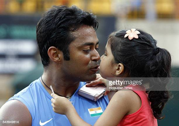 Indian Tennis player Leander Paes kissing his daughter after winning the match against Brazil's Marcelo Mello Bruno Soares in doubles Davis Cup at...