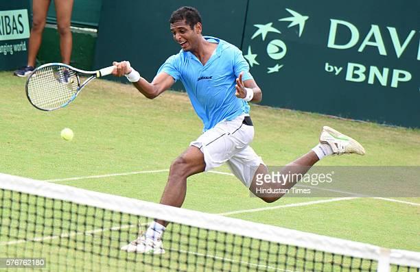Indian tennis player Ramkumar Ramanathan in action against Korean player Yong Kyu Lim during a Davis Cup reverse match between India and Korea at...