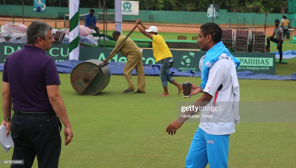 Indian Tennis player Ramkumar Ramanathan talking to officials on the grass court a day before of IndiaSouth Korea Davis Cup tie to be played from...