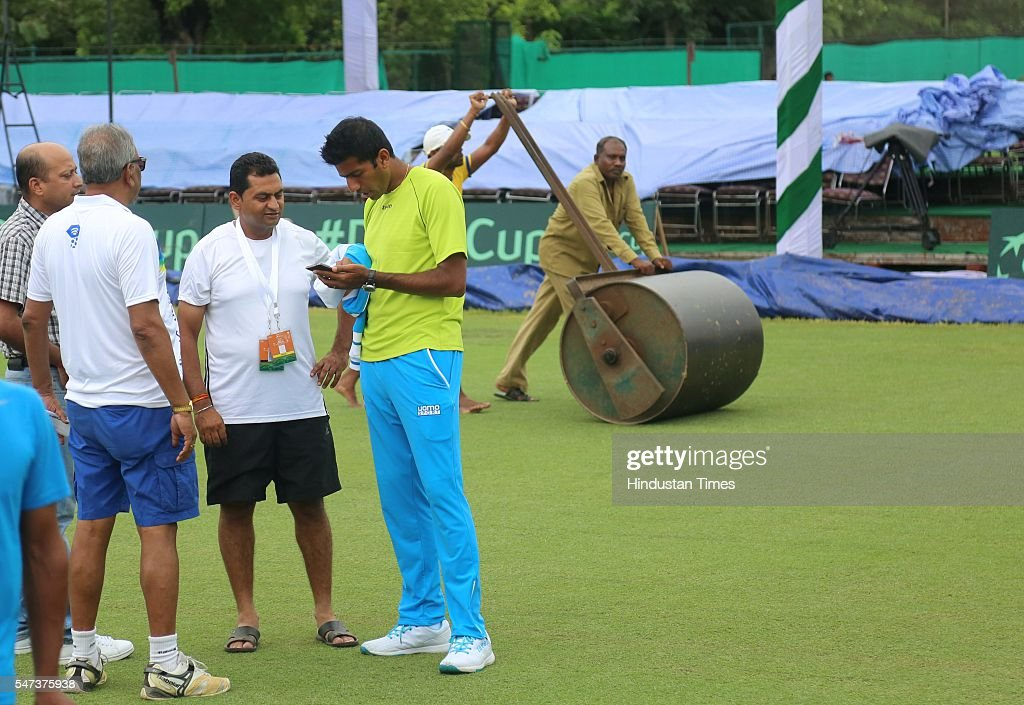 Indian Tennis player Rohan Bopanna talking to officials on the grass court a day before of IndiaSouth Korea Davis Cup tie to be played from July 15...
