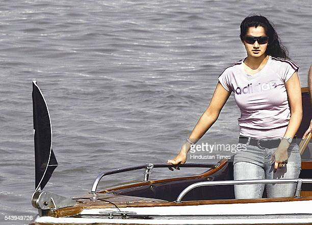 Indian tennis player Sania Mirza arrives on a boat for a promotional event for adidas company off the coast on December 24 2007 in Mumbai India She...