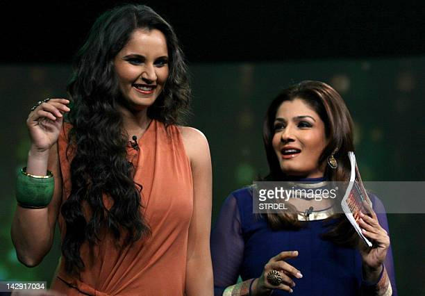 Indian tennis player Sania Mirza interacts with Bollywood actress Raveena Tandon on the set of NDTV's television show Issi Ka Naam Zindagi in Mumbai...