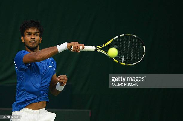 Indian tennis player Sumit Nagal returns a shot against Spain's Marc Lopez during their Davis Cup singles match in New Delhi on September 18 2016 /...