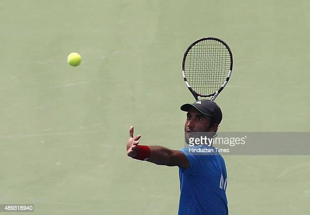 Indian tennis player Yuki Bhambri in action against Czech tennis player Jiri Vesely during a Davis Cup World Group playoff tennis match at R K Khanna...