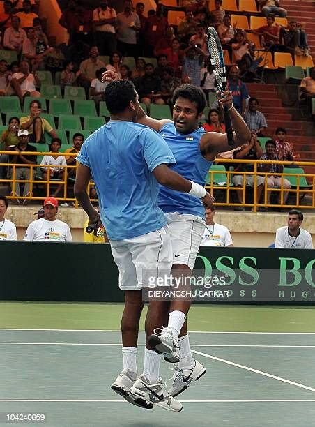 Indian tennis players Mahesh Bhupathi and Leander Paes celebrate during their doubles match against Brazilian pair Marcelo Melo and Bruno Soares, in...