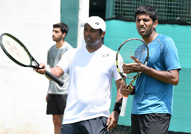 Indian Tennis players Rohan Bopanna and Leander Paes during a practice session ahead of IndiaSouth Korea Davis Cup tie to be played from July 15 to...