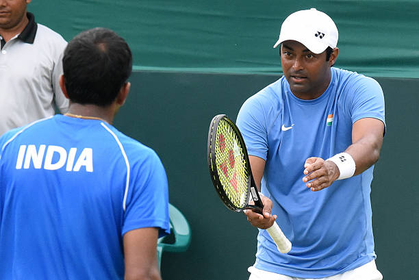 Indian tennis players Rohan Bopanna and Leander Paes in action against Korean players Hong Chung and Yunseong Chung during Doubles match at Davis Cup.