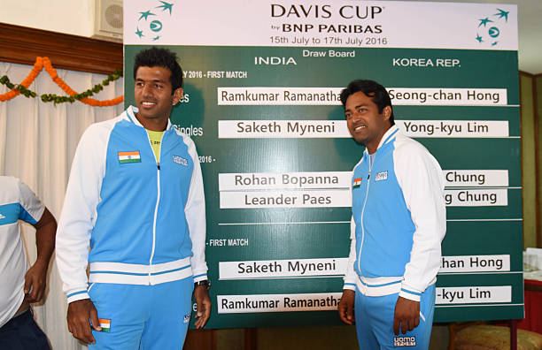 Indian Tennis players Rohan Bopanna and Leander Paes with draw board after the draw ceremony of Davis Cup between India and Korea at Haryana Raj...