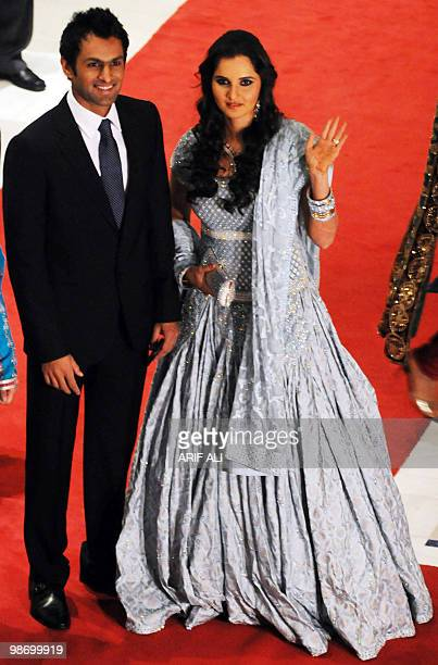 Indian tennis star Sania Mirza arrives with her husband and Pakistani cricketer Shoaib Malik to their wedding reception in Lahore on April 27 2010...