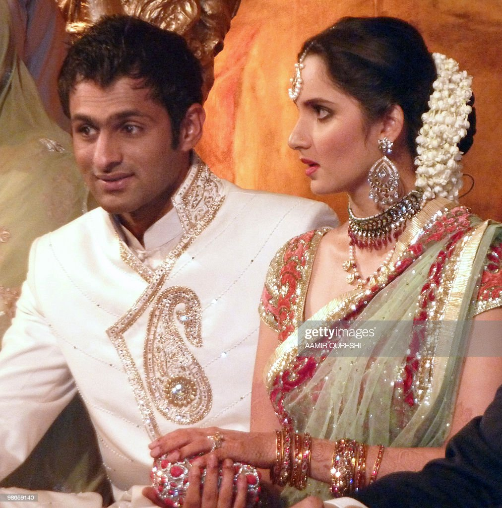 Indian tennis star Sania Mirza sits with her husband and