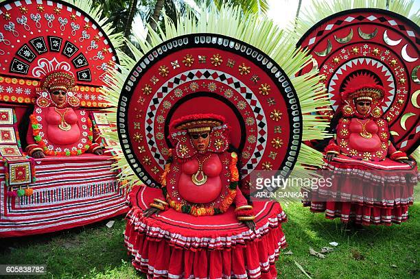Indian 'Theyyam' artists perform during the 'Kummati Kali' as part of the annual Onam festival celebrations in Thrissur district of southern Kerala...