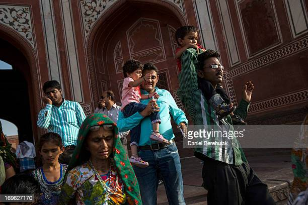 Indian tourists visit the Taj Mahal on May 29 2013 in Agra India Completed in 1643 the mausoleum was built by the Mughal emperor Shah Jahan in memory...