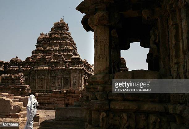 Indian tourists walks inside the Mallikarjun temple complex in Pattadakkal near the southern Indian city of Gadag around 450 KM northwest of...