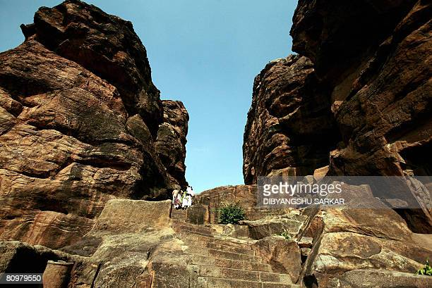 Indian tourists walks up the steps leading to the carved temples at Badami near the southern Indian city of Gadag some 450 Kms northwest of Bangalore...