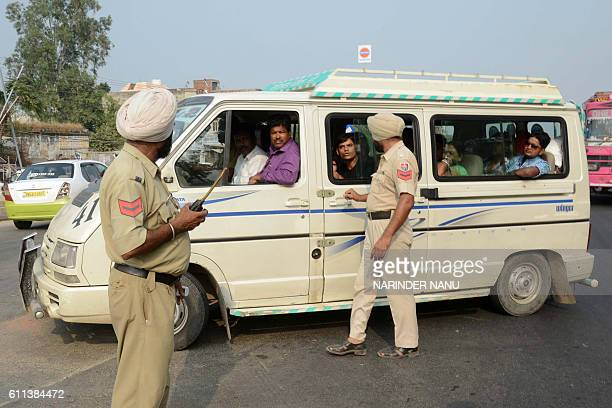 Indian tourists who came to watch the 'daily retreat' ceremony are turned away by police at the Indian side of the IndiaPakistan Wagah border post...