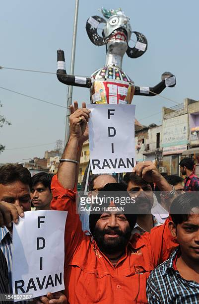 Indian traders protest in front of an effigy representing a Foreign Direct Investment Ravana in New Delhi on October 23 2012 The rally was organised...