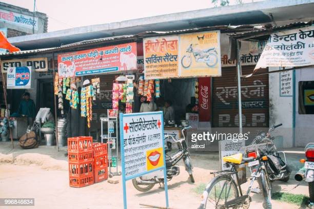 indian traditional street shop market in rural area - emerging markets stock photos and pictures