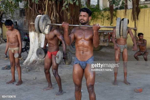 Indian traditional wrestlers known as Pehalwans train at an outdoor gymnasium in Amritsar on February 11 2017 Kushti wrestling is popular across the...