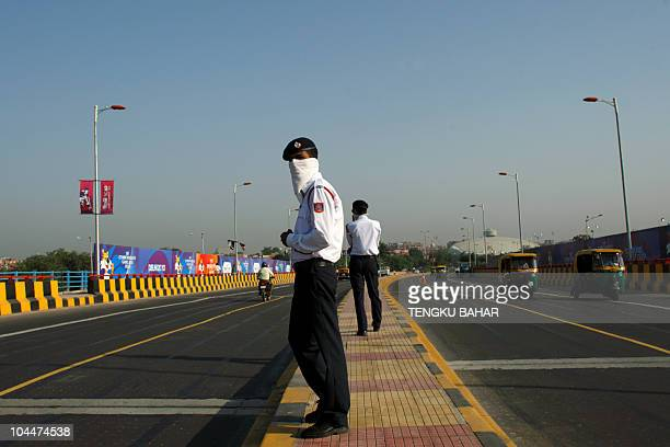 Indian traffic police keep watch as they enforce vehicular activity on Commonwealth Games vehicle lanes authorised for Gamesspecific vehicles only in...