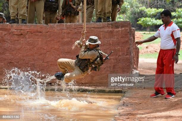 Indian trainee recruits undergo physical endurance training at the Parachute Regiment Training Centre in Bangalore on August 18 2017 Para is a...