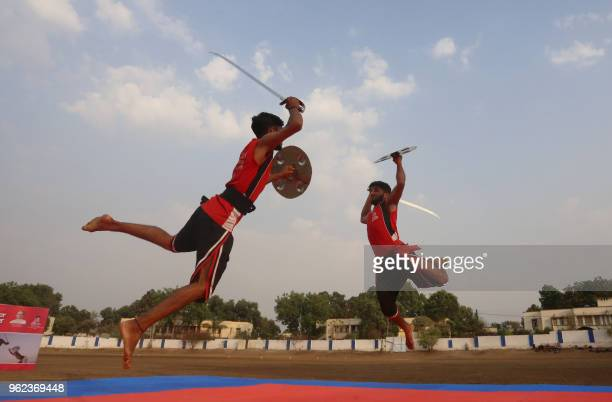 Indian trainees at the Pazhassiraja Kalari Academy in Kanuur take part in a 'Kalaripayattu' display at the Ankur Cricket Academy in Bhopal on 25 May...