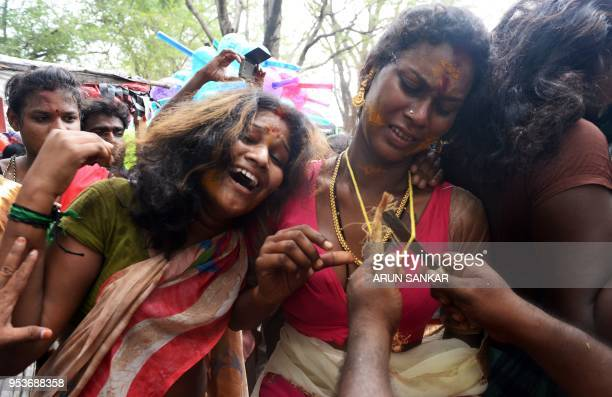 Indian transgender devotee react as a Hindu priest removes their 'thali' sacred thread and bangles following a ritual signifying their marriage to...