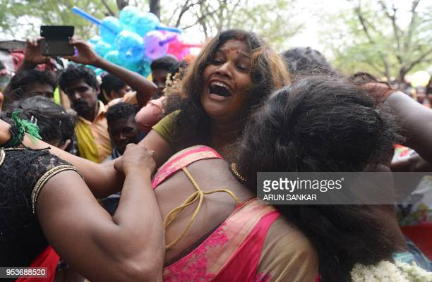 Indian transgender devotees react after a Hindu priest removed their 'thali' sacred thread and bangles following a ritual signifying their marriage...