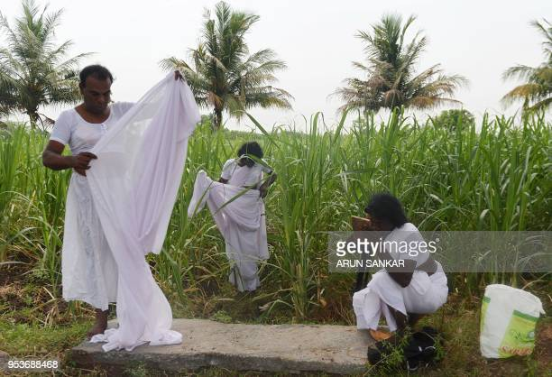 Indian transgender devotess dress up with white saris after a ritual signifying their marriage to the Hindu warrior god Aravan at the Koothandavar...