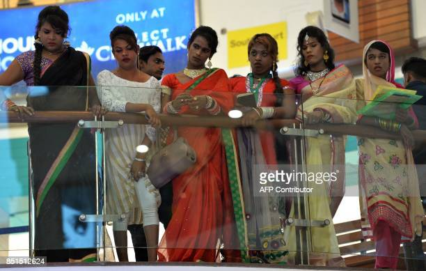 Indian transgenders look at a performance during a 'Hijra Habba' event with the theme 'All citizens equal Inclusion' at a shopping mall in New Delhi...
