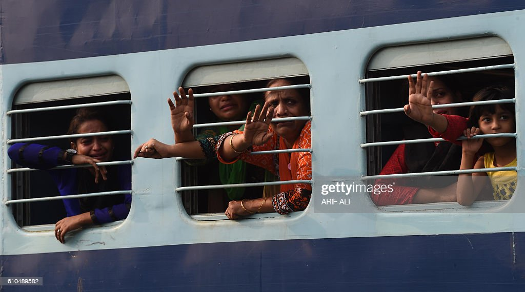 Indian travelers wave as they leave on the Indiabound Samjhota Express from Lahore Railway Station in the Pakistani city of Lahore on September 26...