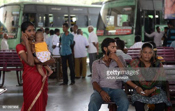 Indian travellers wait at a bus depot during a transport strike in Chennai on January 5 2018 The Tamil Nadu State Transport Corporation is on an...