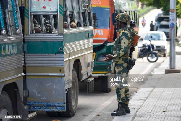 Indian trooper speaks to a new trooper who arrived at Airport road in Srinagar Fear and confusion have gripped residents in India administered...
