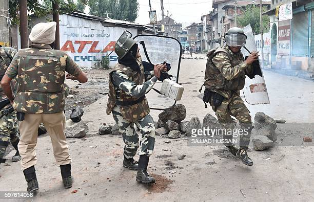 TOPSHOT Indian troopers use shields to protect themselves during a clash with Kashmiri protestors in Srinagar on August 29 2016 Authorities lifted a...