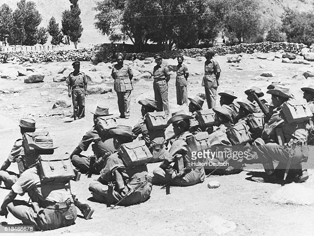 Indian troops being inspected before leaving their posts in the Ladakh border region during the war between India and China, 1962-63.