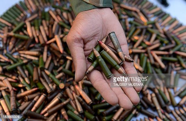 Indian troops display arms and ammunition captured from suspected militants after a gun battle in the Keran sector at the Line of control in Srinagar...